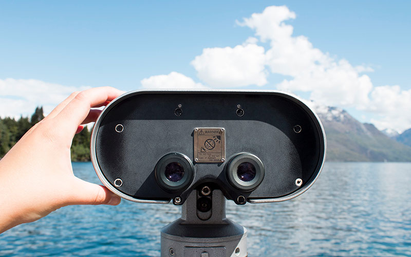 Binoculars looking out on a lake